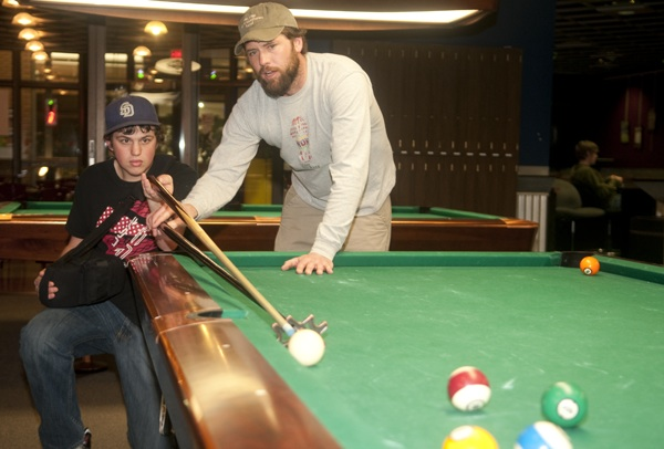 Dax Kannady Lends The Injured Brian Smith A Helping Hand Playing Pool In  The UC Game Room. Smith And Kannady Were Paired Up Through Big Brothers Big  Sisters ...